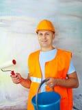 Колеривщики дома с роликом краски Стоковая Фотография