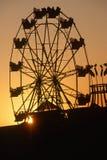 Колесо Ferris на заходе солнца Стоковая Фотография