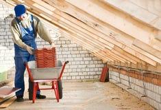колесо roofer строителя кургана стоковое изображение rf