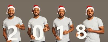 Коллаж чернокожего человека с 2018 деревянными портретами номеров Стоковая Фотография RF