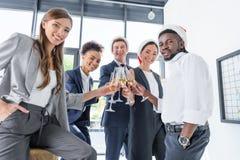 Коллеги выпивая шампанское в офисе Стоковая Фотография RF