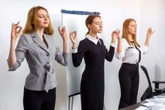 Коллеги в офисе размышляют Стоковые Фотографии RF