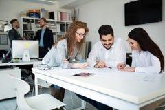 Коллеги дела на их рабочем месте в офисе Стоковое фото RF