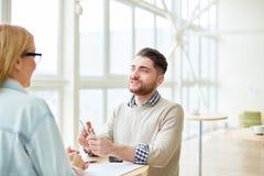 Коллеги на встрече в столовой Стоковое фото RF