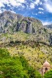 Колокольня перед горой Kotor стоковая фотография rf