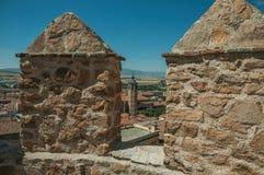 Колокольня церков между крышами увиденными от crenel в стене на Авила стоковая фотография rf