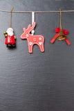 Колокол рождества, красный северный олень и Santa Claus Стоковое Фото