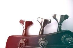 Колышки басовой гитары на голове шеи с влиянием градиента стоковая фотография rf