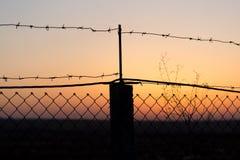 колючий провод захода солнца Стоковое Изображение RF