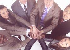 Команда дела стоя при руки сжиманные совместно стоковая фотография rf