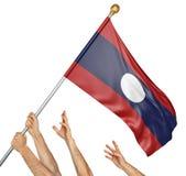 Команда людей вручает поднимать национальный флаг Лаоса Стоковая Фотография RF