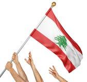 Команда людей вручает поднимать национальный флаг Ливана Стоковое фото RF