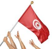 Команда людей вручает поднимать национальный флаг Туниса Стоковое фото RF