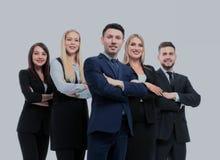 Команда успешных и уверенно людей представляя на белом backgr Стоковое Фото