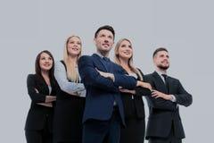 Команда успешных и уверенно людей представляя на белом backgr Стоковые Изображения
