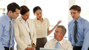Business team talking in front of laptop Stock Footage