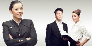 Команда молодых успешных бизнесменов Стоковое фото RF