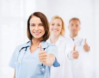 Команда докторов показывая большие пальцы руки вверх Стоковые Фотографии RF