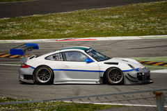 Команда Порше 911 (997) GT3 r Ebimotors на Монце Стоковое фото RF