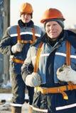 Команда построителей работников на строительной площадке Стоковое фото RF