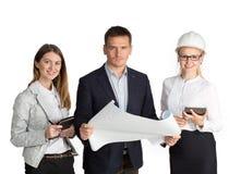 Команда работая совместно в офисе белизна изолированная предпосылкой Стоковое фото RF