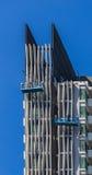 Команда работника работая на фасаде высокого здания Стоковые Изображения