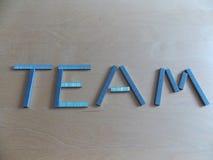 Команда сказанная по буквам вне в штапелях стоковые изображения rf