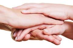 Команда штабелируя руки для мотивировки Стоковое Фото