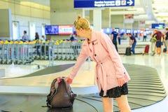 Коммерсантка в авиапорте Стоковая Фотография