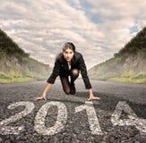 Коммерсантка готовая для того чтобы начать год 2014 стоковые фотографии rf