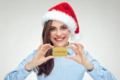 Коммерсантка девушки Санты держа кредитную карточку золота Стоковые Фото