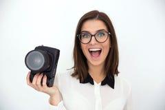 Коммерсантка держа камеру стоковое изображение