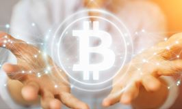 Коммерсантка используя перевод cryptocurrency 3D bitcoins Стоковые Фотографии RF