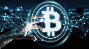 Коммерсантка используя перевод cryptocurrency 3D bitcoins Стоковое Изображение