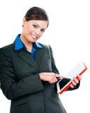 Коммерсантка используя планшет Стоковая Фотография