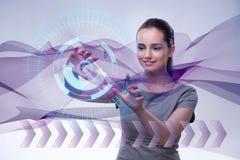 Коммерсантка отжимая виртуальные кнопки в футуристической концепции Стоковая Фотография RF