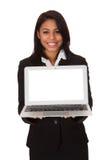 Коммерсантка представляя компьтер-книжку Стоковая Фотография RF