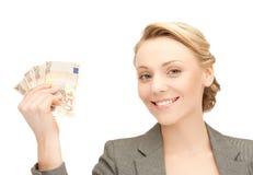 Коммерсантка с деньгами наличных денег евро Стоковое Фото