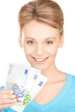 Коммерсантка с деньгами наличных денег евро Стоковые Изображения RF