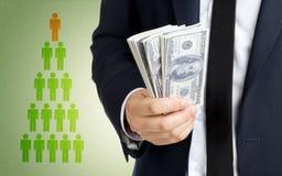 Коммерсантка с деньгами Стоковая Фотография
