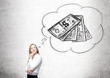Коммерсантка думая о деньгах Стоковая Фотография RF
