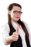 коммерсантка backgroun показывая большие пальцы руки поднимает белизну Стоковые Изображения