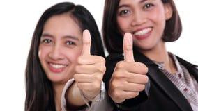 Коммерсантки дают 2 вверх изолированного большого пальца руки Стоковое фото RF