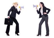 2 коммерсантки держа loudpspeakers Стоковые Фотографии RF