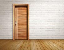 Комната кирпича с современной дверью Стоковые Изображения