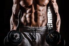 Комод мышцы мужской стоковые фотографии rf