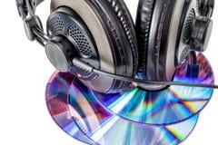Компактные диски и наушники стоковое фото rf