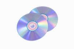 КОМПАКТНЫЙ ДИСК или DVD на белой предпосылке Стоковые Изображения RF
