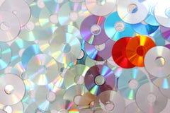 КОМПАКТНЫЙ ДИСК цвета и DVD Стоковые Фото