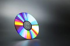 Компактный диск на сером цвете Стоковое Фото